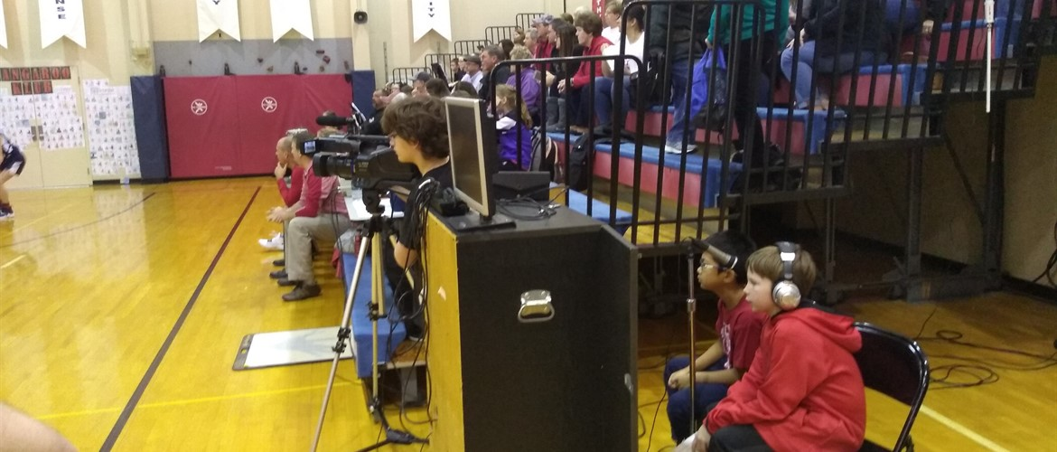 Students live stream a basketball game.