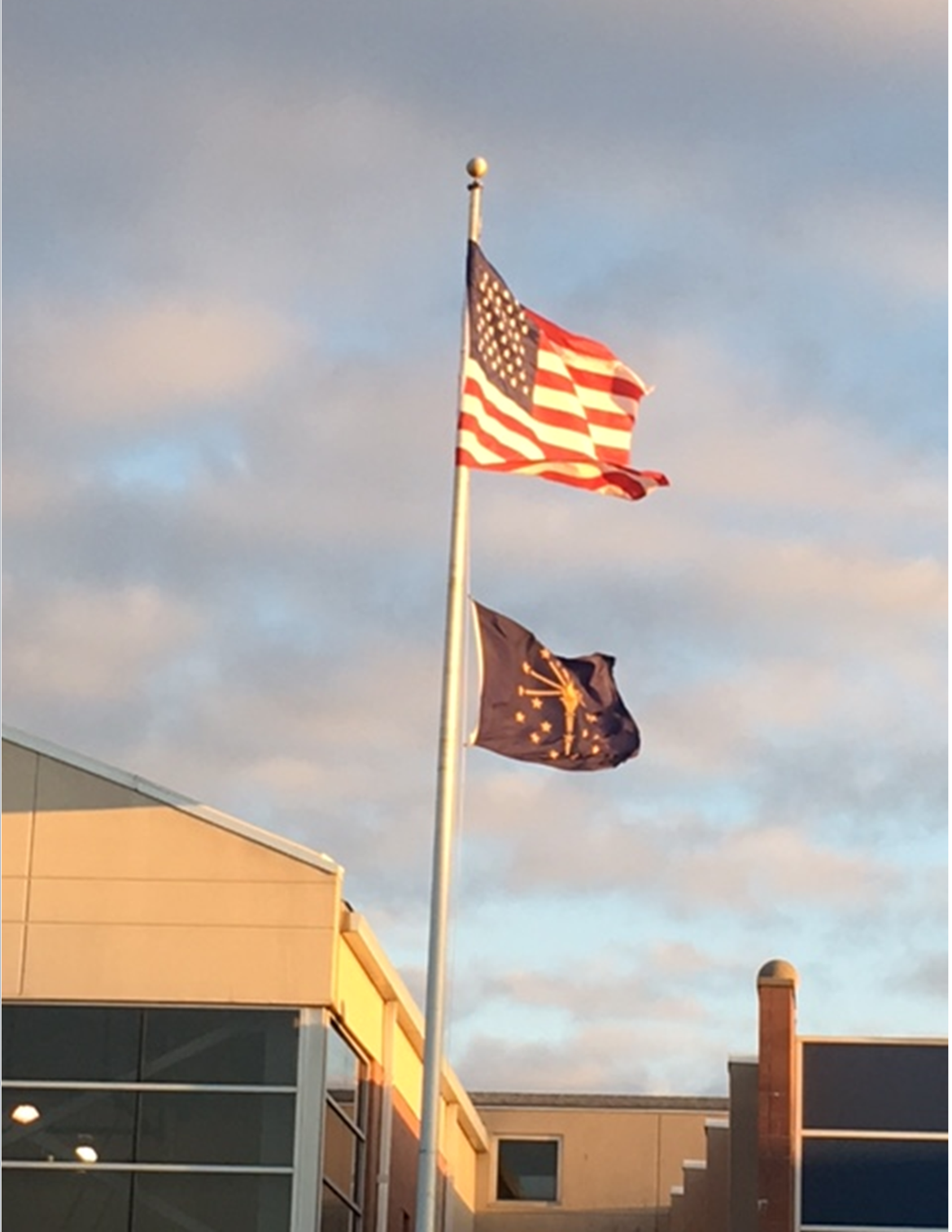 US flag and Indiana flag flying proudly out in front of school.