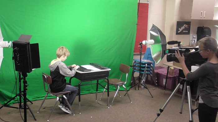 Students rehearse a scene in front of the green screen at WTE.