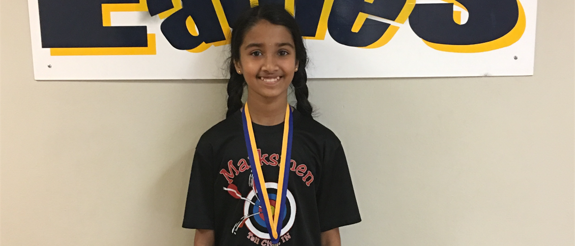 Aniksha with archery medal.