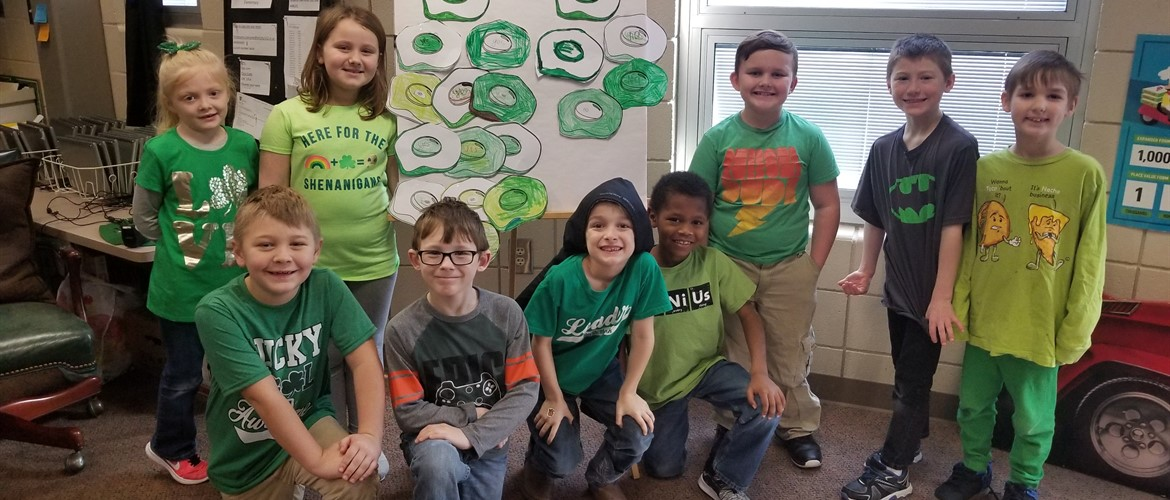 Students pose in green for Read Across America.