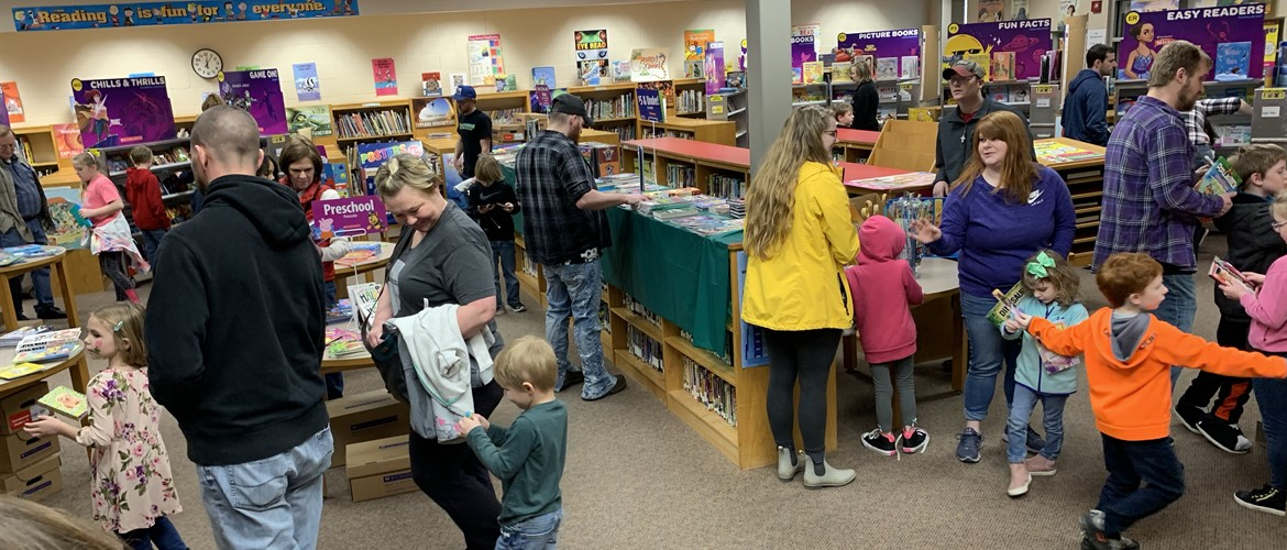Students browse at the Book Fair at the Winter Carnival.
