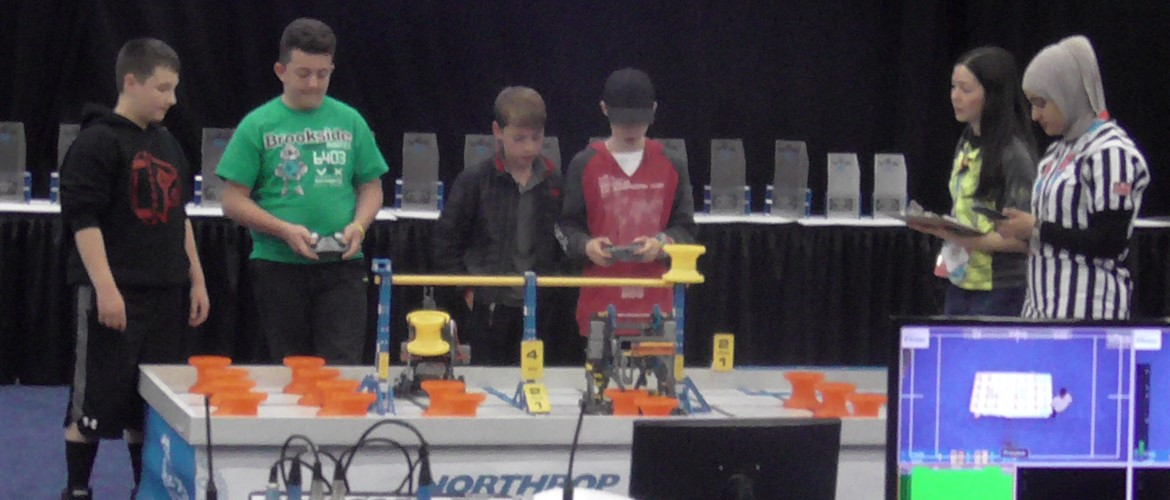 Students competing at VEX robotic competition.