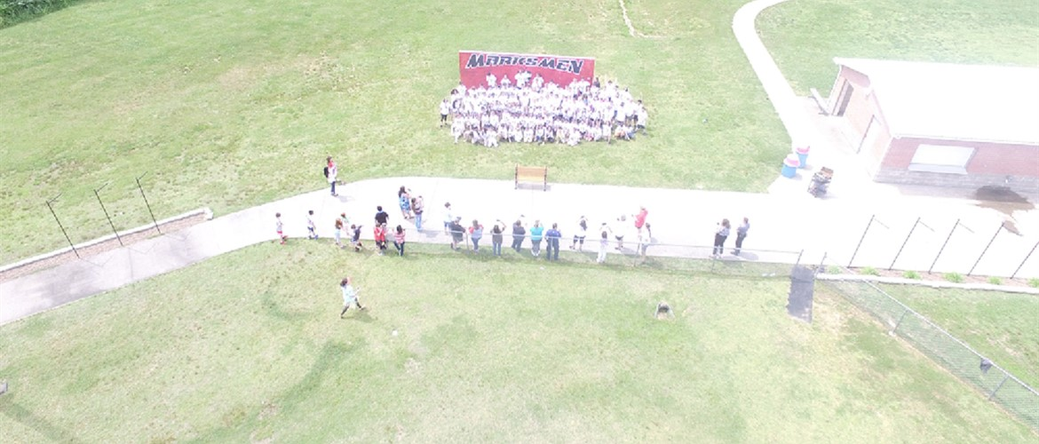 Drone shot of 6th grade in their bright white shirts before the color run.