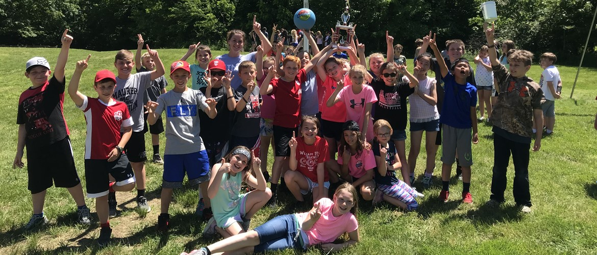 Ms. Terry's class celebrates 1st place in the kickball championship.