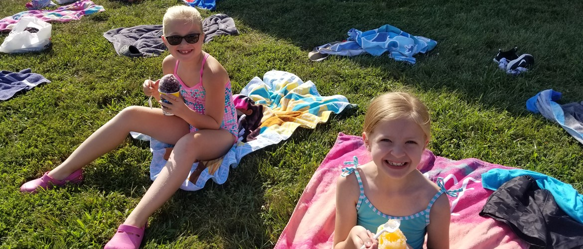 Kids on WTE beach enjoying snow cone.