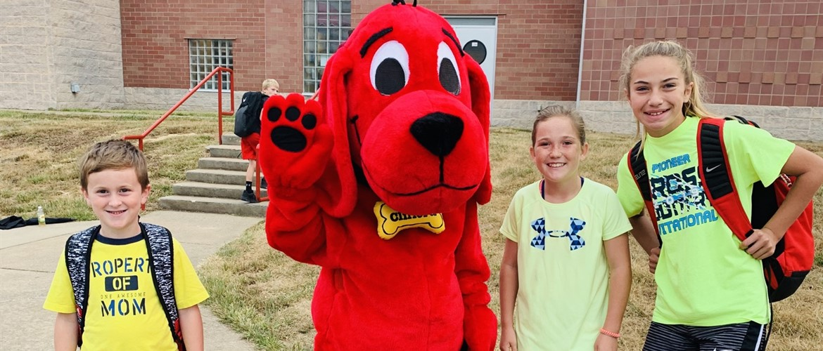 Clifford the Big Red Dog with students.