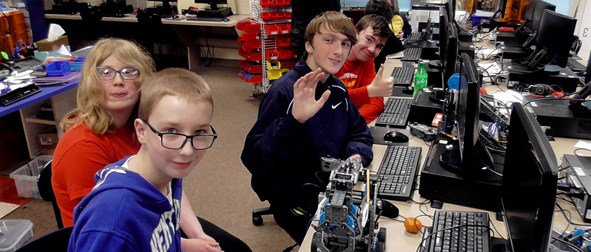 VEX students at computers coding their robot.