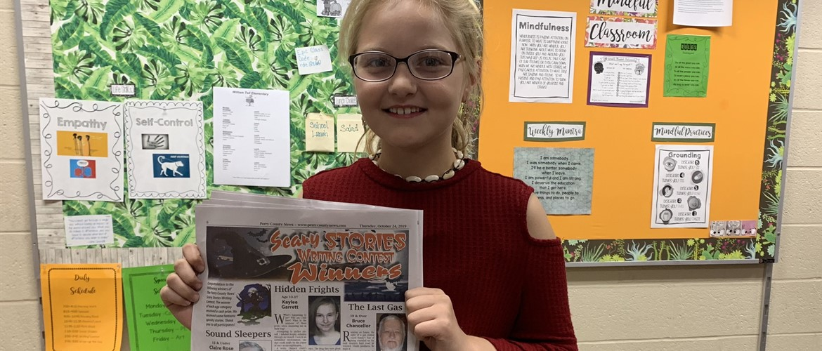 Student  wins local writing contest for her scary story.