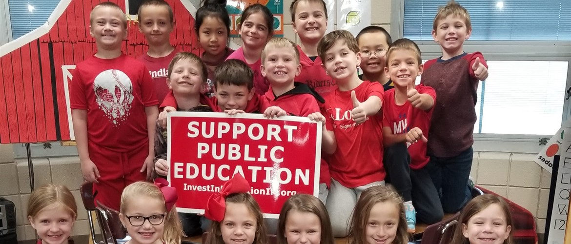 Students with Support Public Education sign.