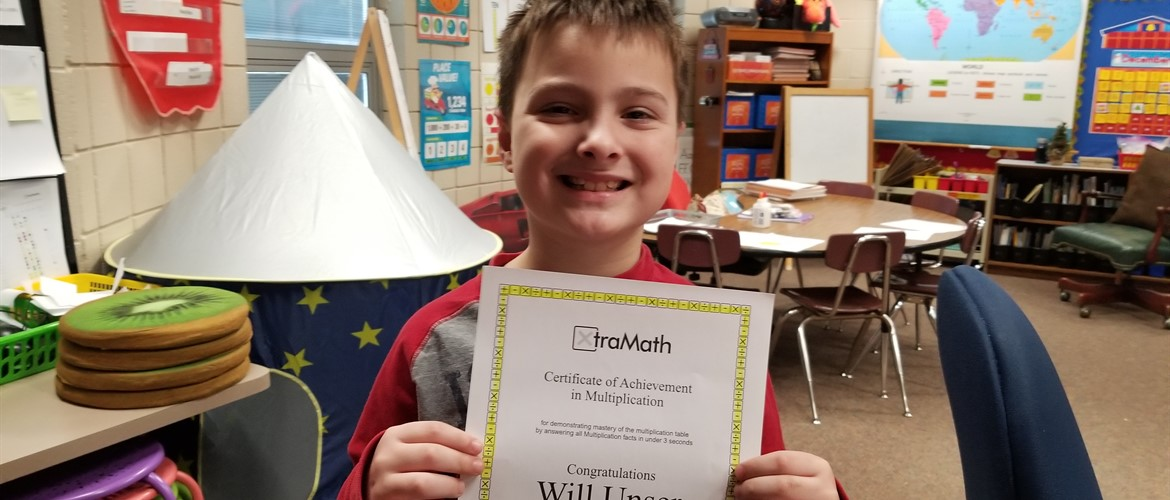 Student with certificate for Xtra Math completion.
