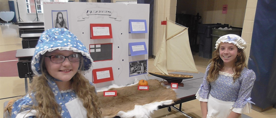 Students with colonial fair project.