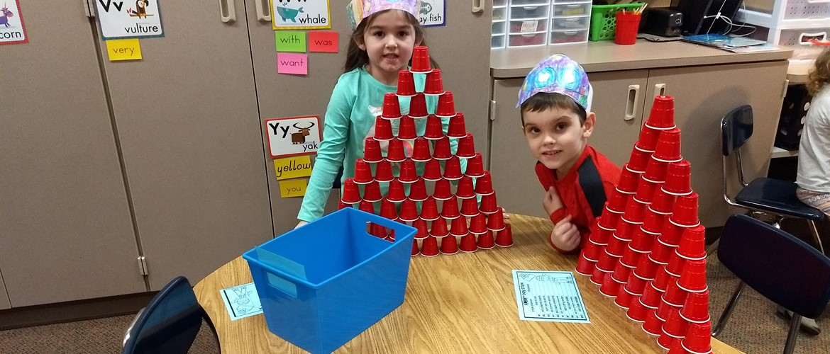 Students pose with their cup structures.