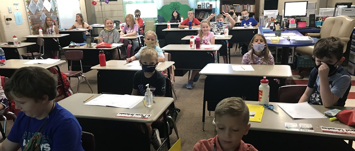 Students in traditional desk rows to help with social distancing.