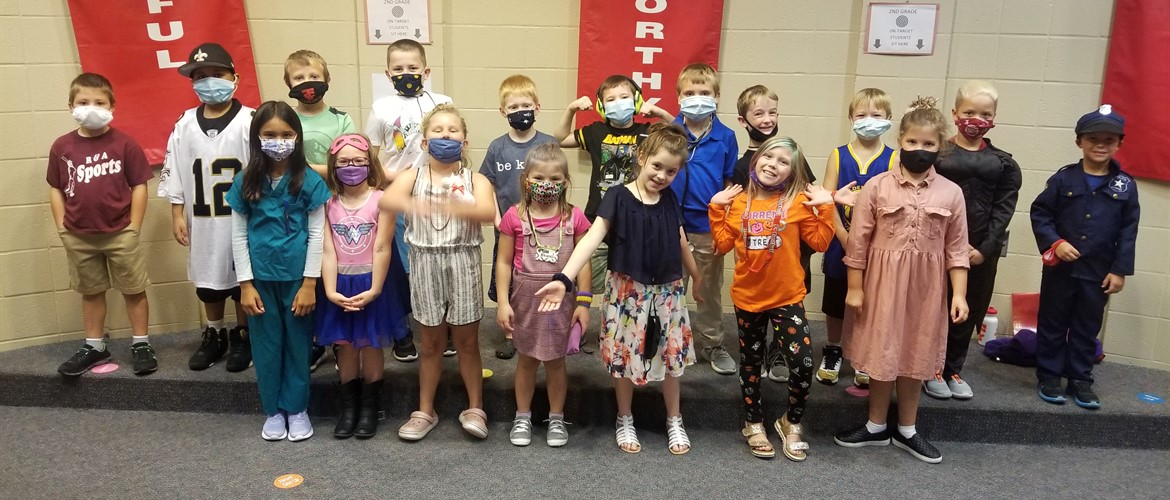 2nd Grade students pose in what they want to be when they grow up.