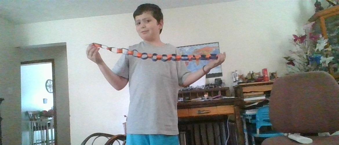 Student displaying paper chain.