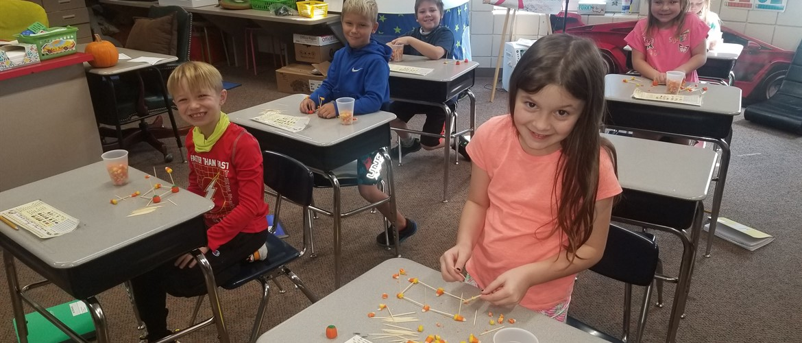 Students starting their candy corn towers.