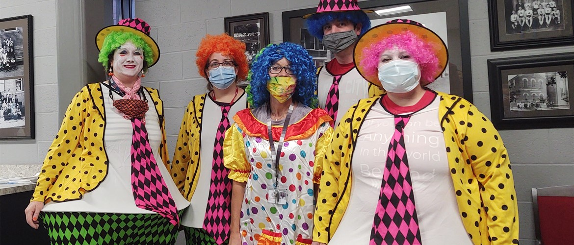 KG teachers dressed as clowns.