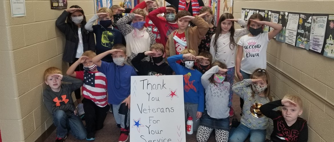 Students saluting Veterans.