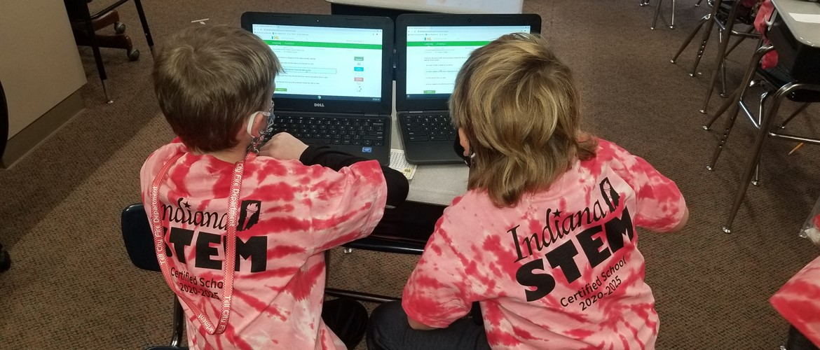 Students wearing STEM Certification shirts.