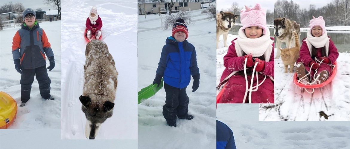 Kids in sledding outfits during a snow day.