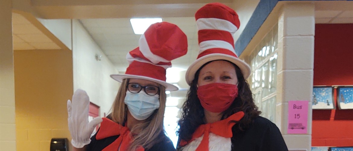 Two teachers dressed as the Cat in the Hat