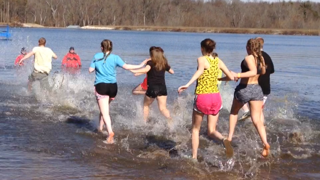 Polar Plungers testing the waters before plunging into the frigid waters. Brrr. See more photos in the Photo Gallery.