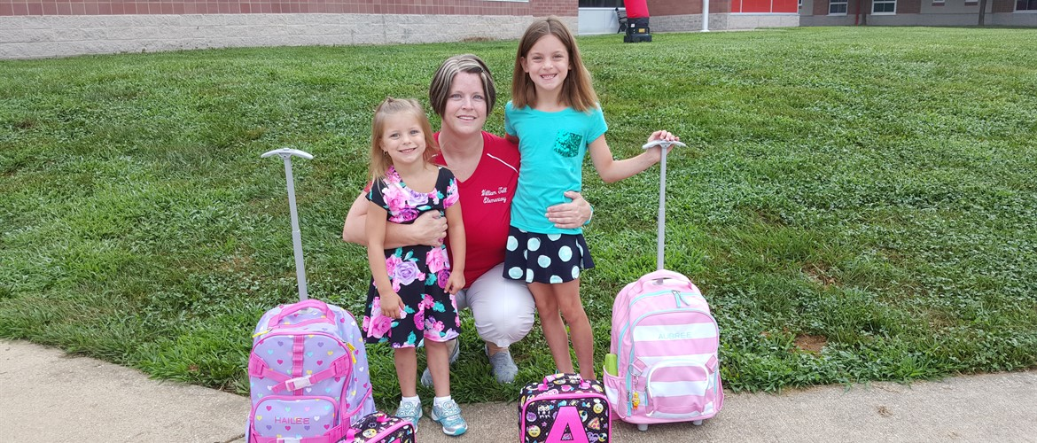 Hailee, Ms. Napier, and Aubree are ready for the first day.