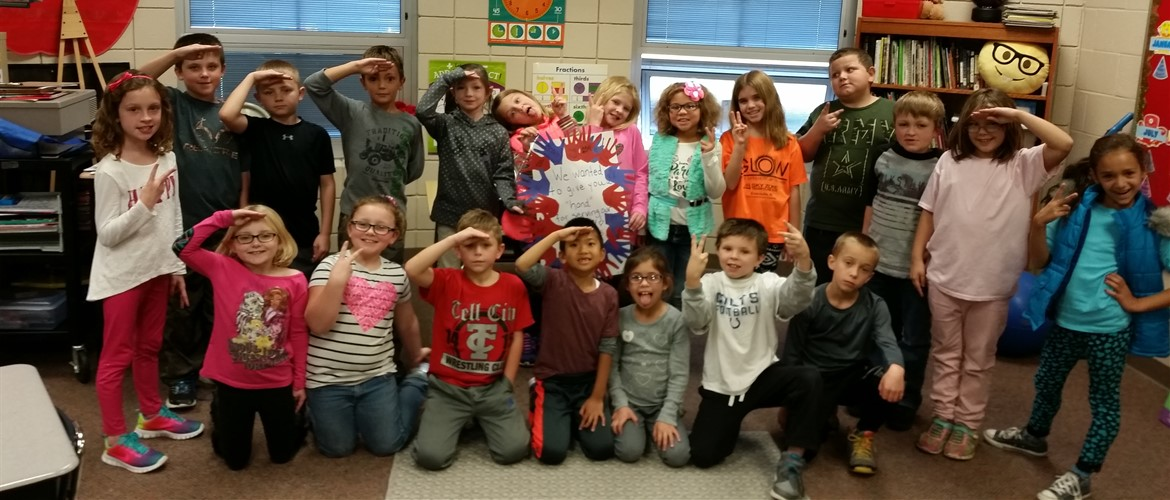 Ms. Hedinger's class gives the veterans a salute for their service!