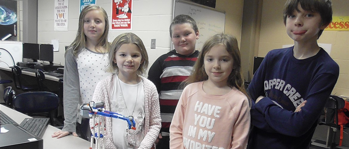 Alexis, Lydia, JR, Addison, and Mason display the Lego crane they made before school. This was teamwork in action.