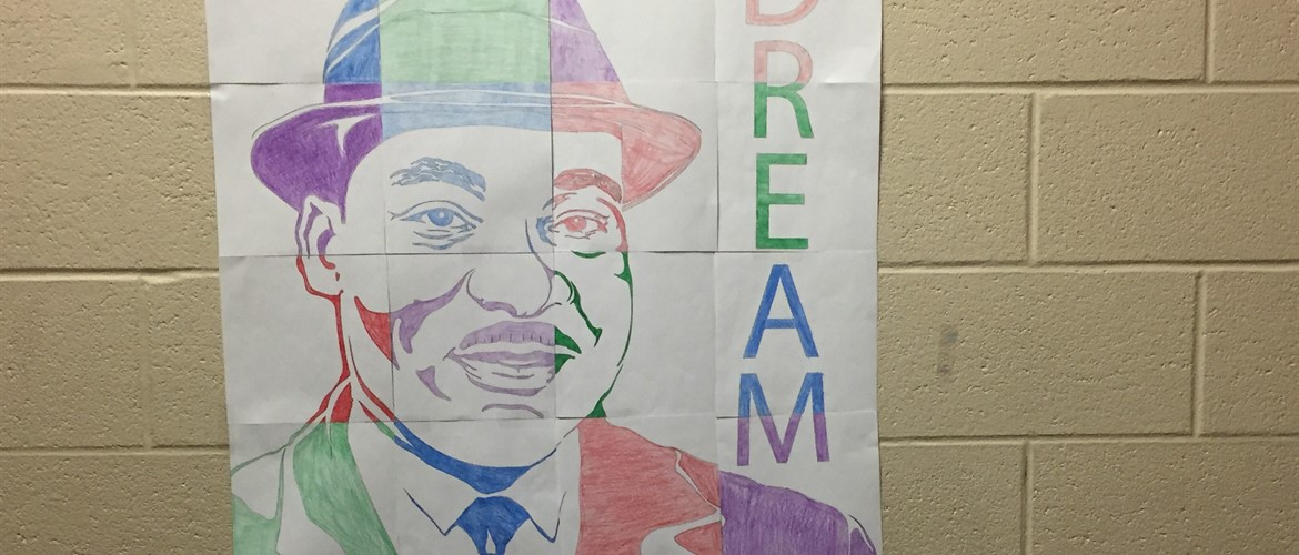 """The function of education is to teach one to think intensively and to think critically. Intelligence plus character - that is the goal of true education."" Martin Luther King.  Ms. Kreilein's class completed this mosaic."