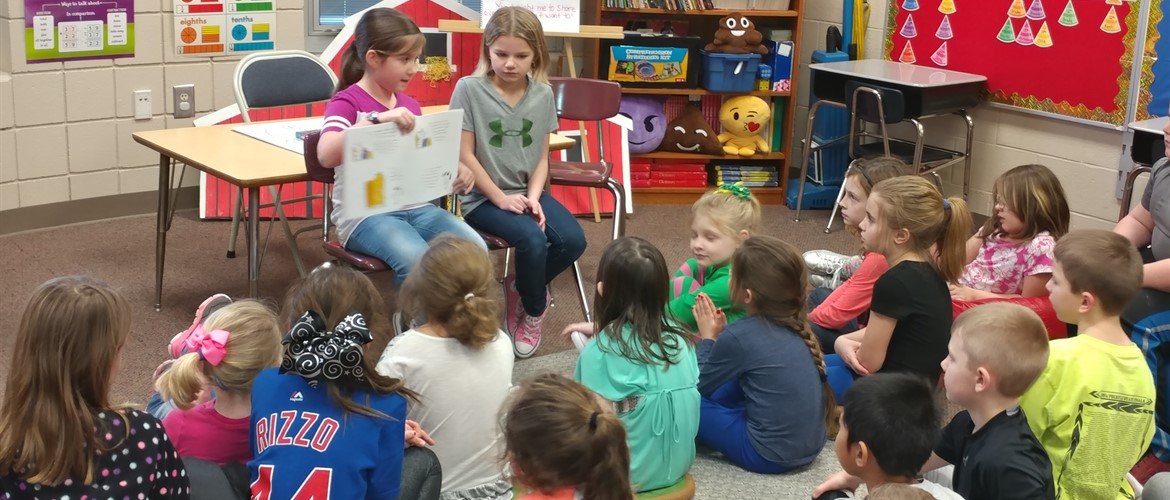 Phoebe G. and Lydia H. reading for Ms Hedinger's class. We love our school!
