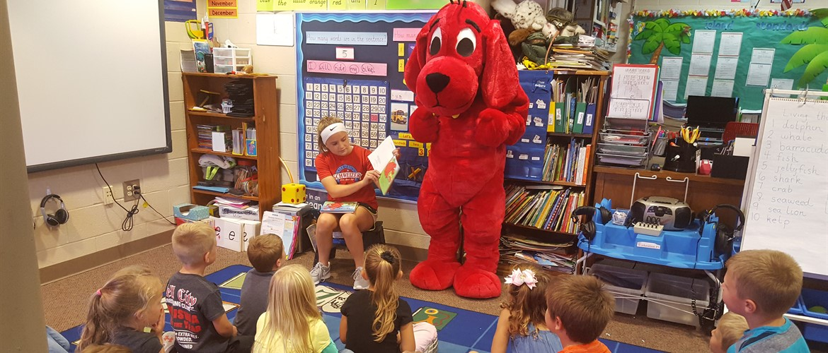 Clifford and helper reading story to a class.