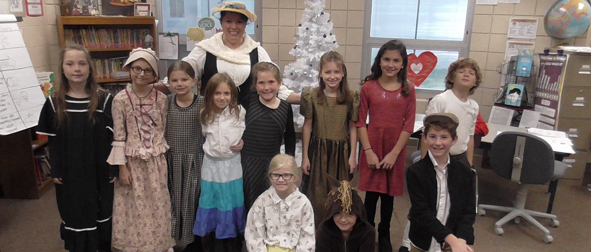 "Ms. Kuric's class in ""johnny Tremain"" style clothing."