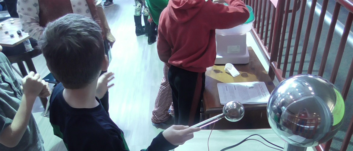 Student using STEM City Van deGraaff generator.