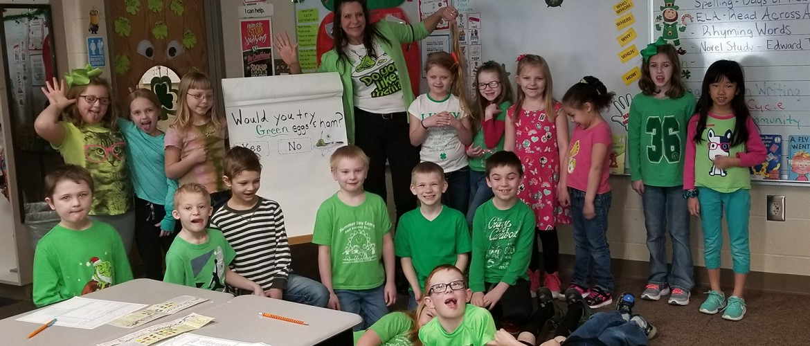 Students posing for Green Eggs and Ham day.