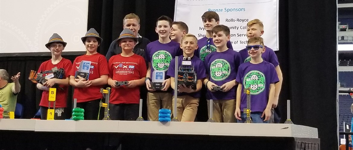 Team B at VEX robotics State championship with 4th place trophy.