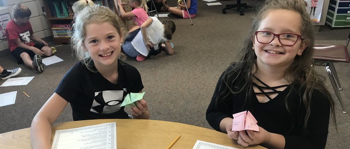 Two students play a game to learn more about each other.
