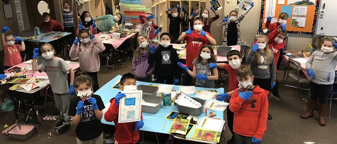 Students in surgical garb operating on text features.