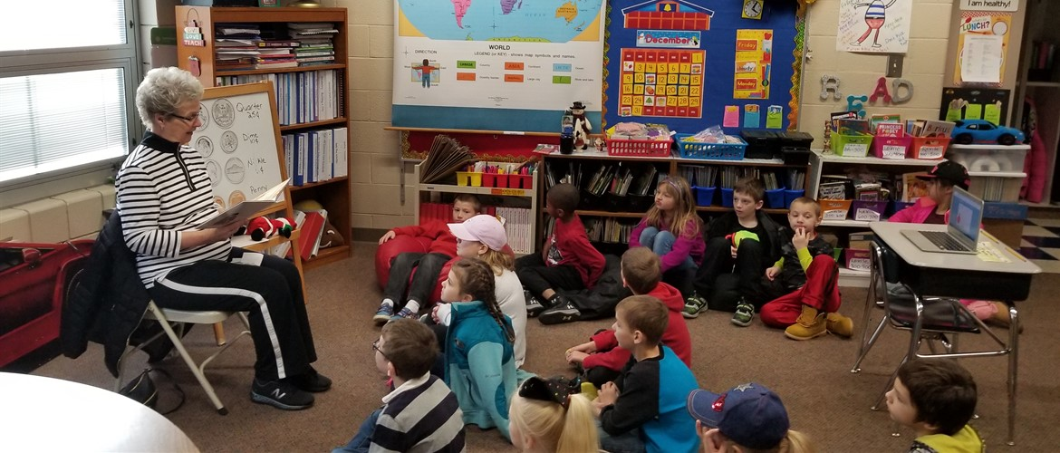 Guest reader reading a book to Ms. Hedinger's class.