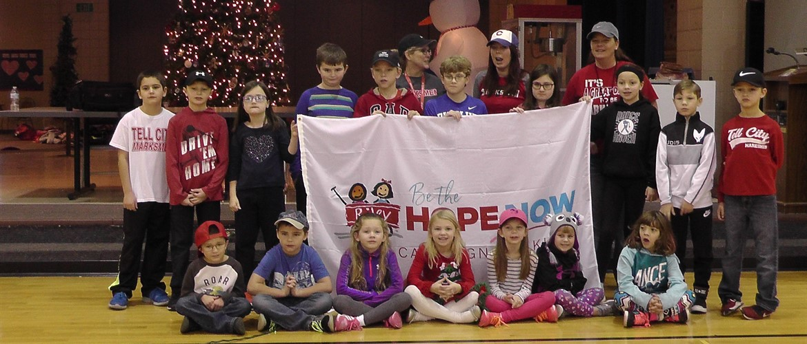 Students display flag helping promote Riley's Be the Hope campaign.