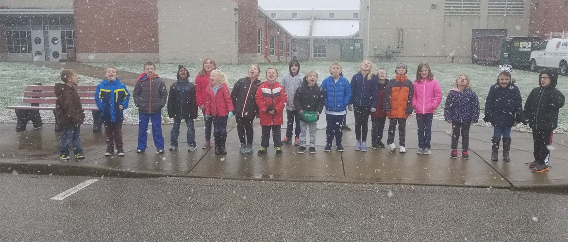 Students catching snowflakes on their tongues.