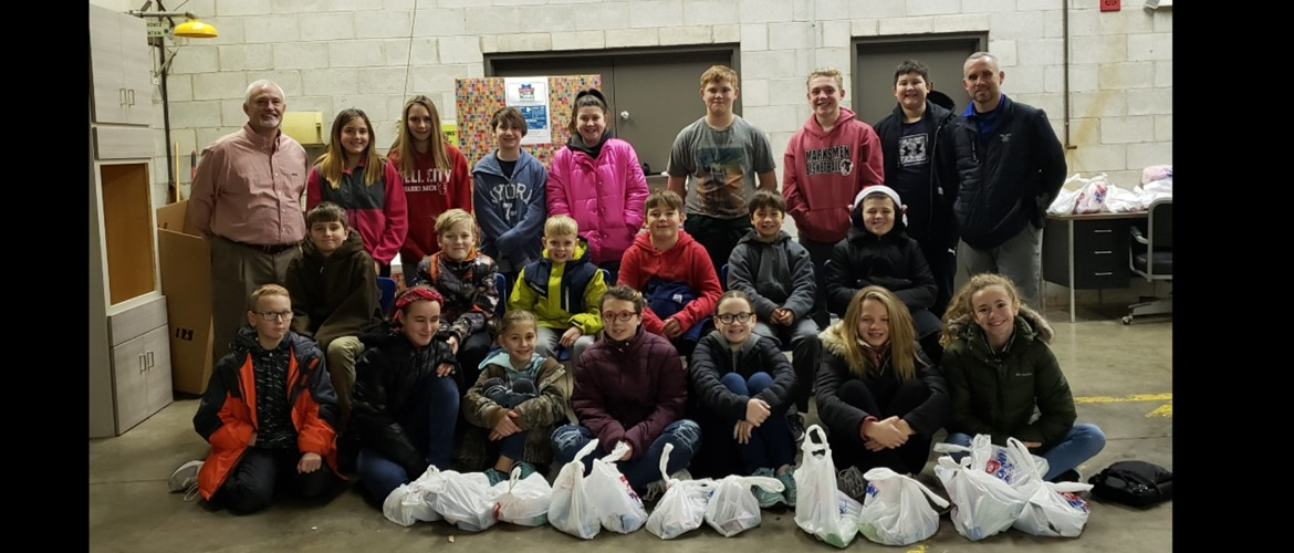 6th grade students at IVy Tech with bags they have collected of everyday items for those in need.